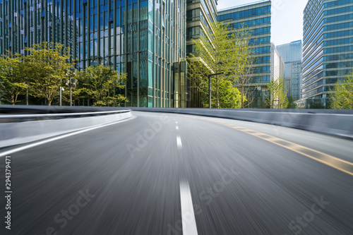 empty highway with cityscape and skyline of qingdao,China. Wallpaper Mural