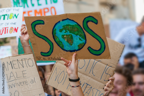 Obraz Fridays for future: students hands showing  banners and boards - fototapety do salonu