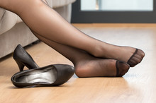 Woman Legs With Black Nylons Resting