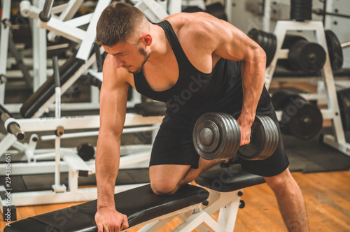 Fotobehang Fitness Fitness instructor in the sport room background. Male model with muscular fit and slim body. Sport concept