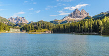 Beautiful Famous Misurina Lake In Dolomites, Italy. Landscape With Lake, Mountains, Blue Sky Reflected In Water.
