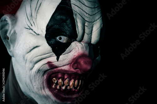 Stampa su Tela scary evil clown with a bloody mouth