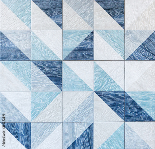 modern-ceramic-tile-with-geometric-pattern-and-imitation-of-wood-texture-in-gray-and-light-blue-colors