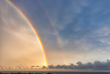 Fototapeta Rainbow - Stunning two big rainbows after the rain over the sea