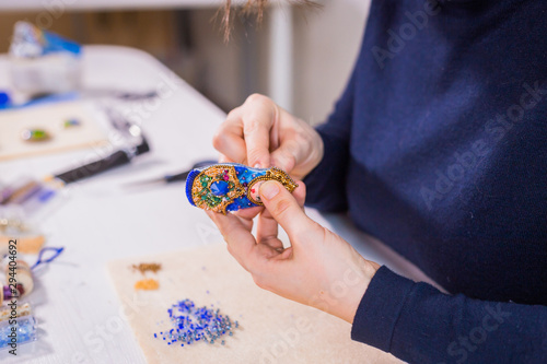 Designer making handmade brooch Canvas Print