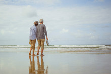 Senior Couple Walking On The B...