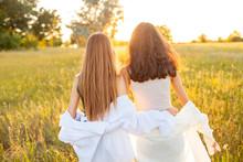 Two Young Women In White Shirt...