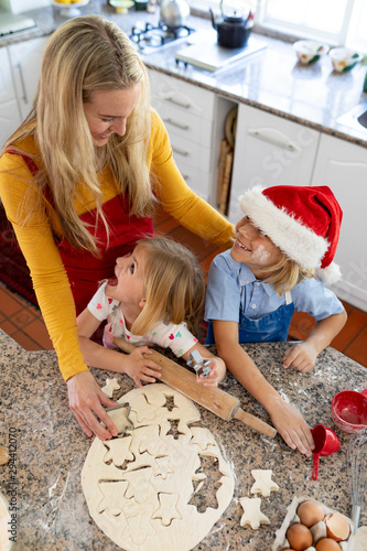 Family making Christmas cookies at home