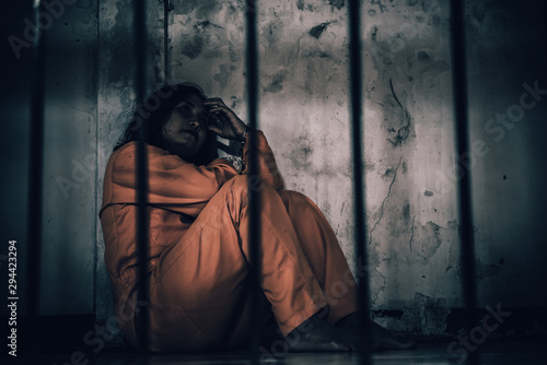 Portrait of women desperate to catch the iron prison,prisoner concept,thailand people,Hope to be free,If the violate the law would be arrested and jailed Wallpaper Mural