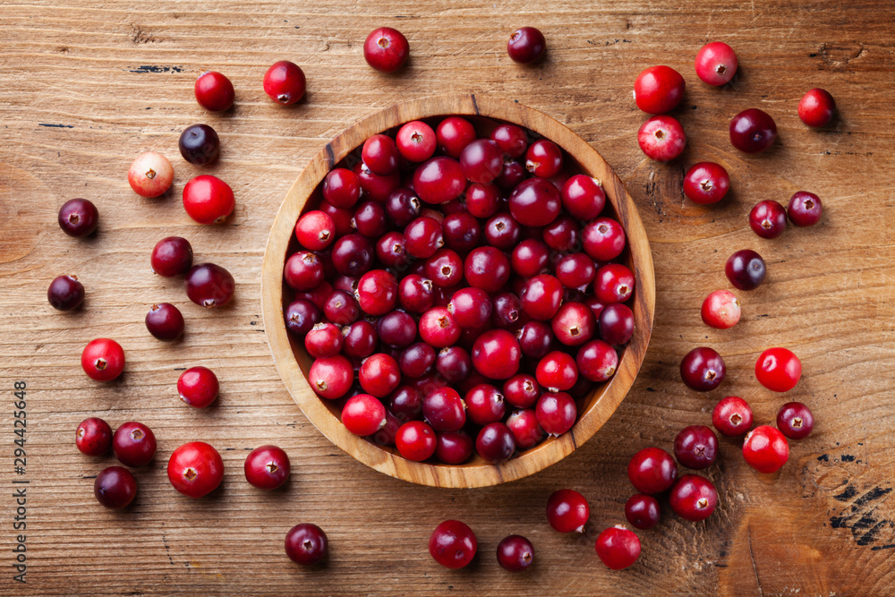 Fototapety, obrazy: Ripe fresh cranberry in wooden bowl on rustic table top view.