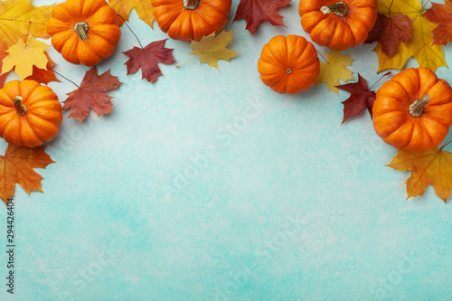 Canvas Prints Wall Decor With Your Own Photos Autumn Thanksgiving background. Pumpkins and maple leaves on turquoise table top view.