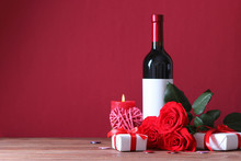 Red Wine And Roses On The Tabl...
