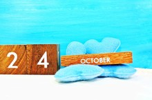 Wooden Calendar On October 24 On A Blue Background.United Nations Day