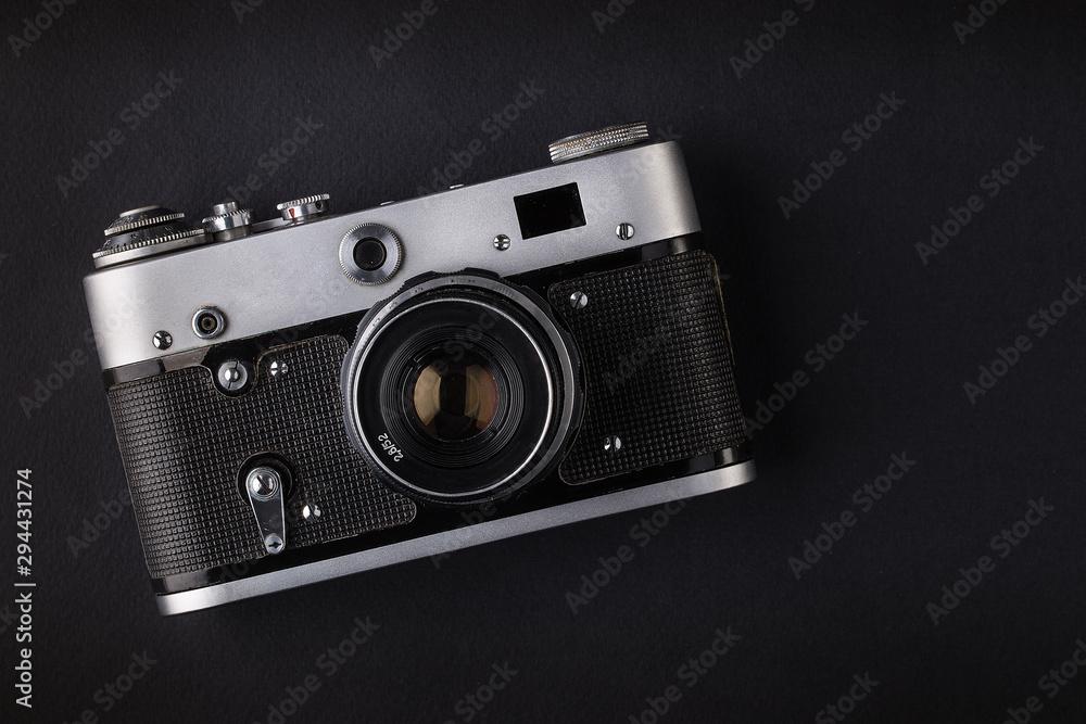 Fototapeta Camera on black background