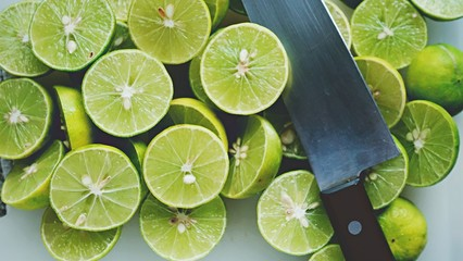 Lime Background. Close up shot of limes. Selective Focus of sliced lime.
