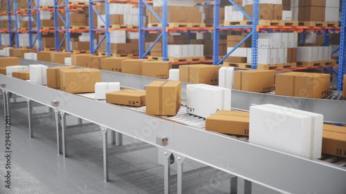 Fotografía Packages delivery, parcels transportation system concept, cardboard boxes on conveyor belt in warehouse