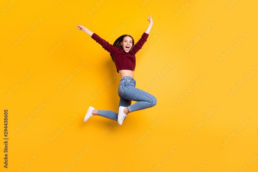 Fototapeta Full length photo of charming cute girl raising her hands screaming wearing burgundy sweater isolated over yellow background