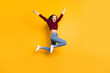 Full length photo of charming cute girl raising her hands screaming wearing burgundy sweater isolated over yellow background