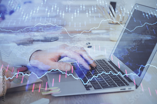 Fototapety, obrazy: Multi exposure of stock market graph with man working on laptop on background. Concept of financial analysis.
