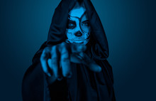 Female In Halloween Costume Pointing At Camera