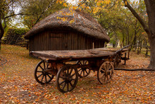 Old Wooden Cart In Front Of An...