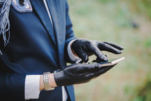Woman In Gloves Uses Smartphone