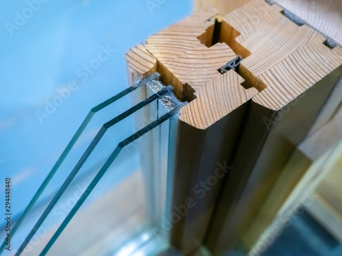 Fototapeta Glazing of buildings. Installation of windows. Window device with triple glass. Sectional metal-plastic window. Window device made of metal-plastic. The business of installing windows. obraz