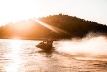 Jet Ski Going Fast At Sunset