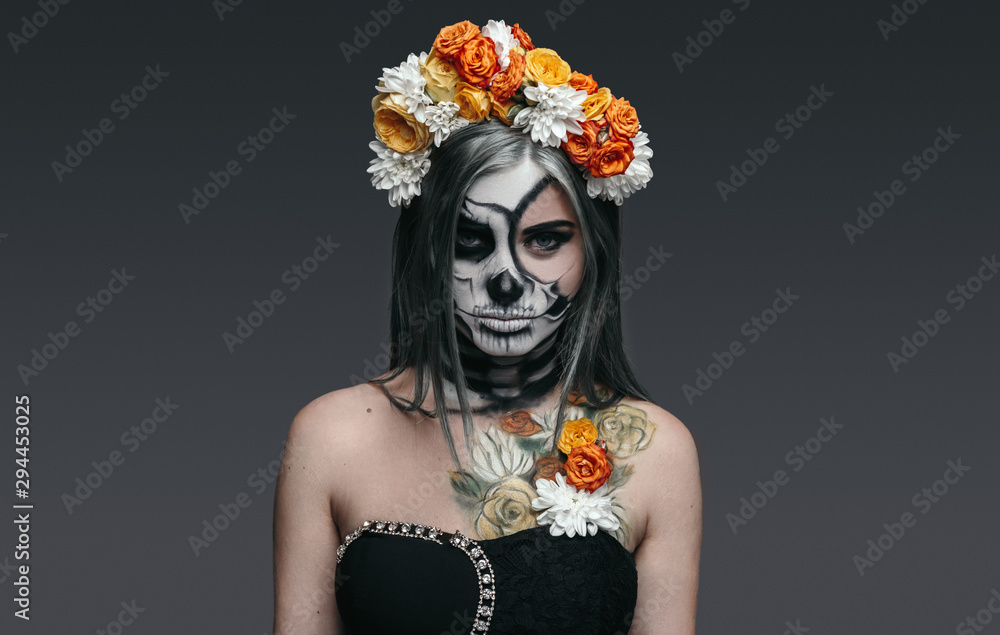 Fototapeta Serious witch with flowers on head