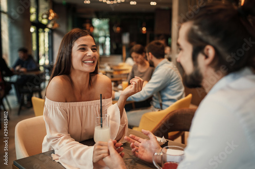 Young happy couple at a date in a cafe - 294453402