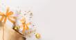 Leinwandbild Motiv Present boxes with gold ribbon inside shopping bag on white