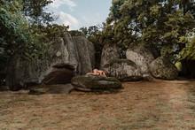 Nude Woman Lying On A Rock At Beglik Tash Prehistoric Rock Sanctuary, Bulgaria