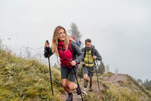 Young Couple On A Hiking Trip In The Mountains, Herzogstand, Bavaria, Germany
