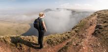 UK, Wales, Brecon Beacons, Young Woman Hiking At Bannau Sir Gaer Ridge