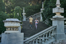 Man And Woman Running On Stairs