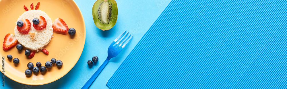 Fototapety, obrazy: top view of plates with fancy animals made of food on blue background, panoramic shot