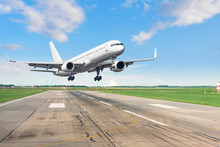 Passenger Plane Lands On Runway At Airport.