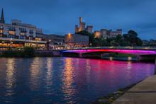 Night Vibrant View Of Pedestrian Bridge Across Ness River, Inverness.