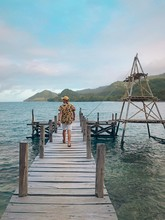 Man Walks On The Ocean Dock