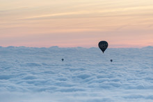 A Group Of Hot Air Balloons Flies Over A Sea Of Clouds In The Region Of La Garrotxa, In Girona (Spain) At Dawn.