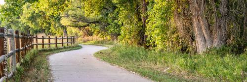 Fototapeta bike trail in early fall scenery