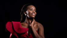 Beautiful Close Up Shot Of Woman African Wearing Red Dress Face With Make Up Fashion, Shooting Studio Shot Isolated On Black Background.