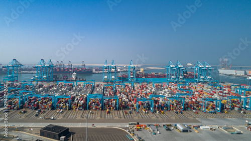 Aerial picture of containers in the harbour of Rotterdam with lot's of different colors