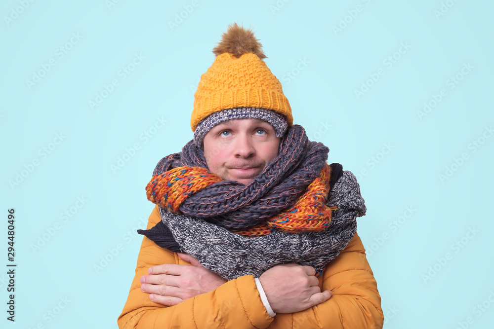 Fototapety, obrazy: Handsome caucasian funny man in several hats and scarfs.