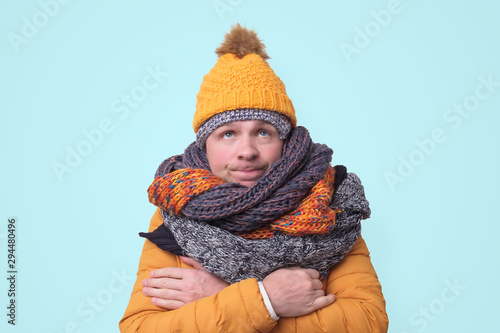 Handsome caucasian funny man in several hats and scarfs. фототапет