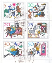 A Block Of Postage Stamps From Germany Which Depicts A German Folk Tale About A Magic Table, A Donkey And A Truncheon