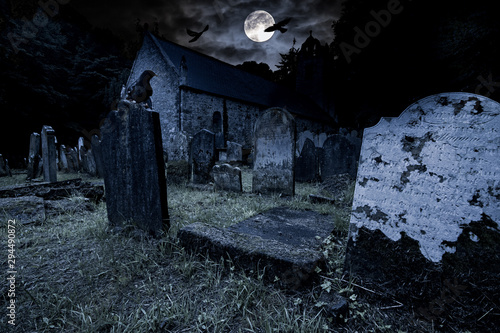 Foto op Canvas Londen old graveyard with ancient tombstones grave stone and old church front of full moon black raven dark night spooky horror background