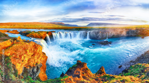 Fantastic sunrise scene of powerful Godafoss waterfall.