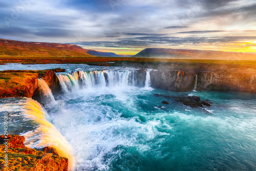 Fantastic sunrise scene of powerful Godafoss waterfall. - 294509080
