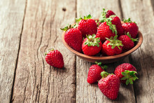 Freshly Picked Strawberry In Wooden Bowl On Wooden Background. Healthy Eating And Nutrition.